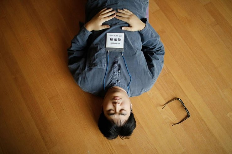 A participant meditates before being locked up in a cell at Prison Inside Me, a mock prison facility, in Hongcheon, South Korea, November 10, 2018. Since 2013, the facility has hosted more than 2,000 inmates, many of them stressed office workers and students seeking relief from South Korea's demanding work and academic culture. Reuters