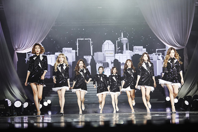Girls' Generation at the press conference held Sunday at Gymnastics Gymnasium in Olympic Park, Seoul. From left, Yuri, Taeyeon, Hyoyeon, Sunny, Seohyun, Yoona, Tiffany and Sooyoung / Courtesy of SM Entertainment