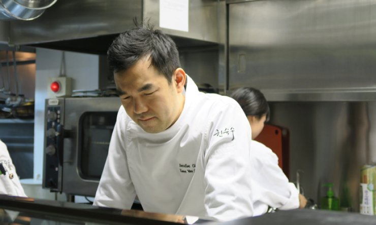 Chef Kwon Woo-joong is in deep thought in his restaurant kitchen before testing a new menu to be released for the winter season. / Korea Times photo by Yun Suh-young