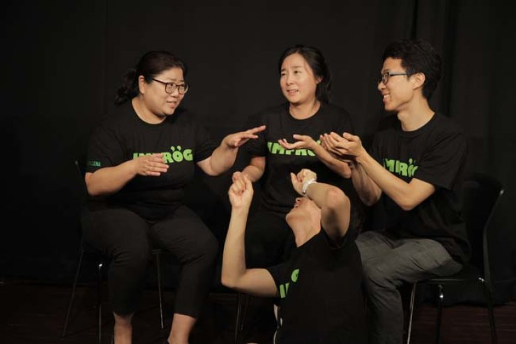 Members of the Korea Improv Society perform on stage.
