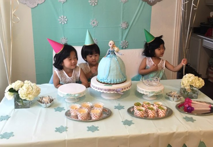 Lauren, center, celebrates her second birthday with sisters Ellen, left, and Ann. Sisterly love is growingstrong as these girls are inseparable. / Courtesy of Jane Han