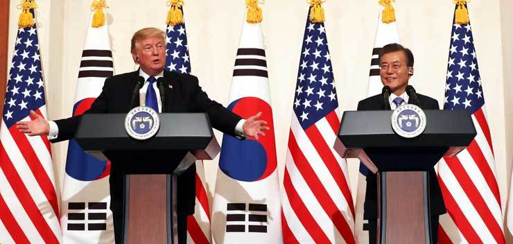 President Moon Jae-in listens to U.S. President Donald Trump during a joint press conference after their summit at Cheong Wa Dae, Tuesday. South Korea is the second stop of the U.S. president's five-nation Asian tour. He departs for China today. / Korea Times photo by Koh Young-kwon.