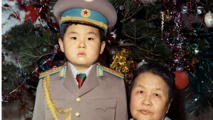 Kim Jong-nam dressed in an army uniform with his maternal grandmother in January 1975.
