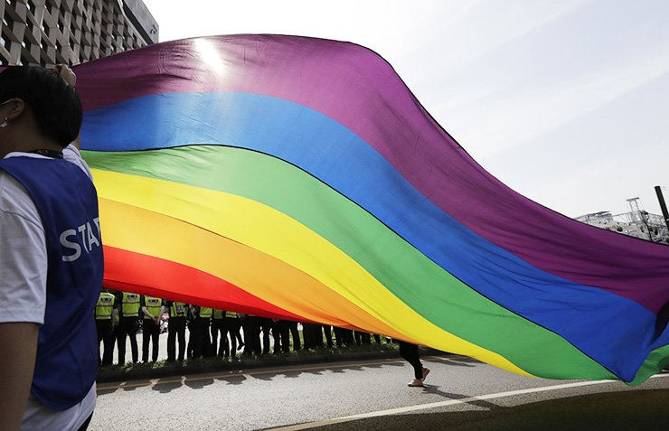 A huge rainbow flag is carried during a parade as a part of the Seoul Queer Culture Festival in Seoul, June 1. Tens of thousands of supporters and visitors participate in the 20th Seoul Queer Culture Festival which is held from May 21 until June 9. AP-Yonhap