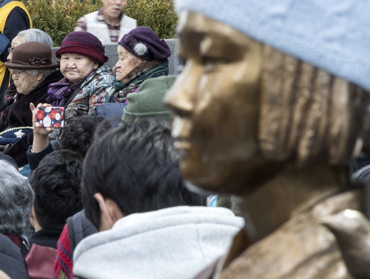 The 'comfort women' statue in front of the former site of the Japanese Embassy. / Yonhap
