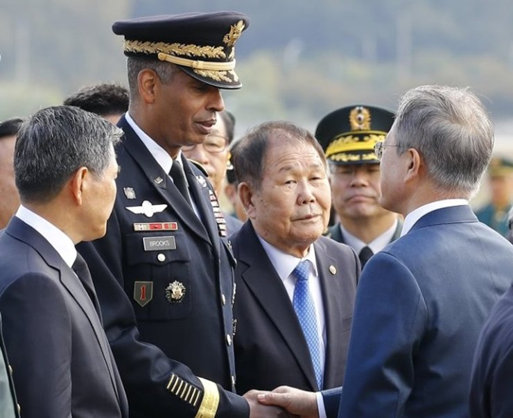 United States Forces Korea (USFK) Commander Vincent Brooks shakes hands with President Moon Jae-in in while participating in an event to commemorate the 70th Armed Forces Day, Oct. 1, in Seoul. / Yonhap