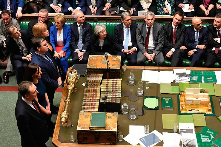 In this image issued by the House of Commons of British Prime Minister Theresa May looks on as MP's announce that she has lost a vote on her Brexit plan on Jan. 15. AP