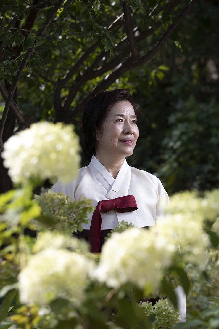 Kim In-ja sewing master and hanbok designer stands in the garden of her workshop in Seoul, Monday. /Korea Times photo by Choi Won-suk