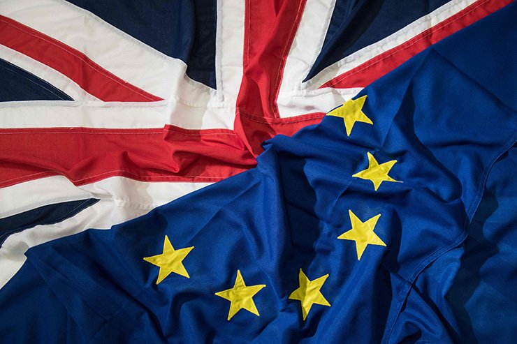 In this file photo taken on March 24, 2017, a picture shows flags arranged as an illustration, a Union Flag (R) and a European Union (EU) flag (L) at the factory of 'Flagmakers' in Chesterfield, northern England. British and European Union negotiators have reached a draft agreement on Brexit, Prime Minister Theresa May's office said on Nov. 13. AFP