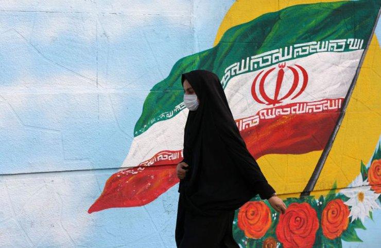 A woman wears a medical mask as a precaution against coronavirus on March 1 in Tehran, Iran. Fatemeh Bahrami―Anadolu Agency/Getty Images