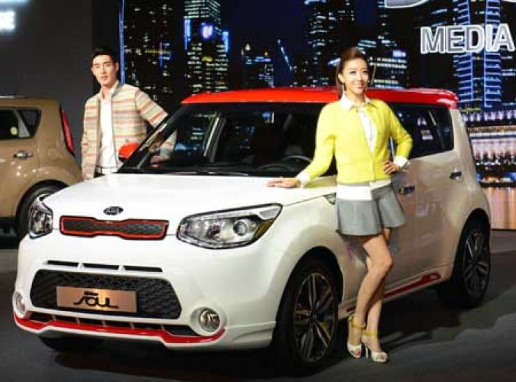 Models pose next to the all-new Soul during a launch event at W Seoul Walkerhill Hotel, Tuesday. / Courtesy of Kia Motors