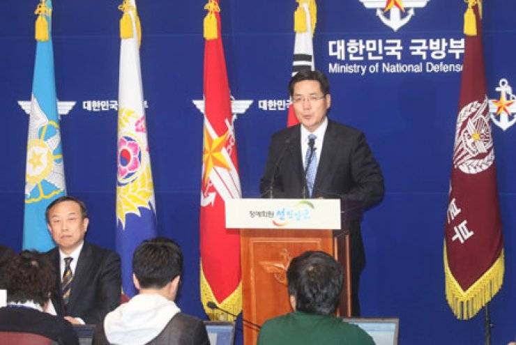 Ministry of National Defense spokesman Kim Min-seok speaks during a press conference to announce the expansion of Korea's air defense identification zone at the ministry, Sunday. At left is Maj. Gen. Jang Hyuk, director general for policy planning. / Yonhap