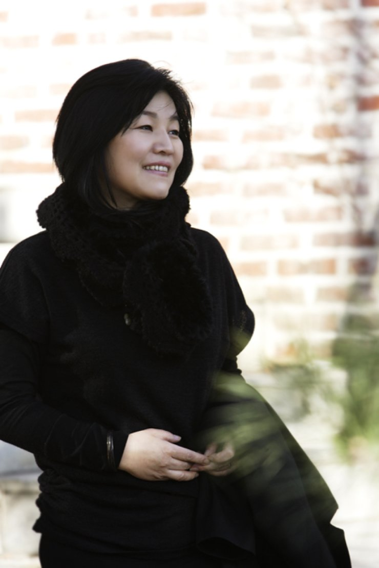 Writer Shin Kyung-sook poses in this file photo. Her 1995 novel will be published as 'The Girl Who Wrote Loneliness' in the United States next fall, her third English book since the first one 'Please Look After Mom' received rave reviews in 2011. / Courtesy of Shin Kyung-sook