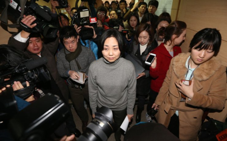 Seoul Philharmonic Orchestra CEO Park Hyun-jung, center, leaves after announcing her resignation during a press conference at the SPO rehearsal room of the Sejong Center for the Performing Arts, Monday. Park has been embroiled in controversy for sexually and verbally abusing her staff. / Yonhap
