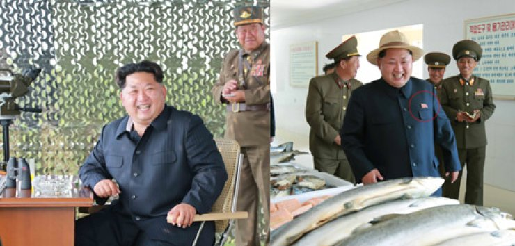 North Korean leader Kim Jong-un, in the left photo, visits an anti-aircraft artillery unit on June 18 as part of his routine field inspections without wearing the badges of former leaders Kim Il-sung and Kim Jong-il. This is in contrast with the May 23 photo, right, in which he wears the badges on the chest during a visit to a military fish farm. The difference led to speculation that the young leader has launched an effort to stand on his own rather than leaning on the former leaders' legacy. / Yonhap