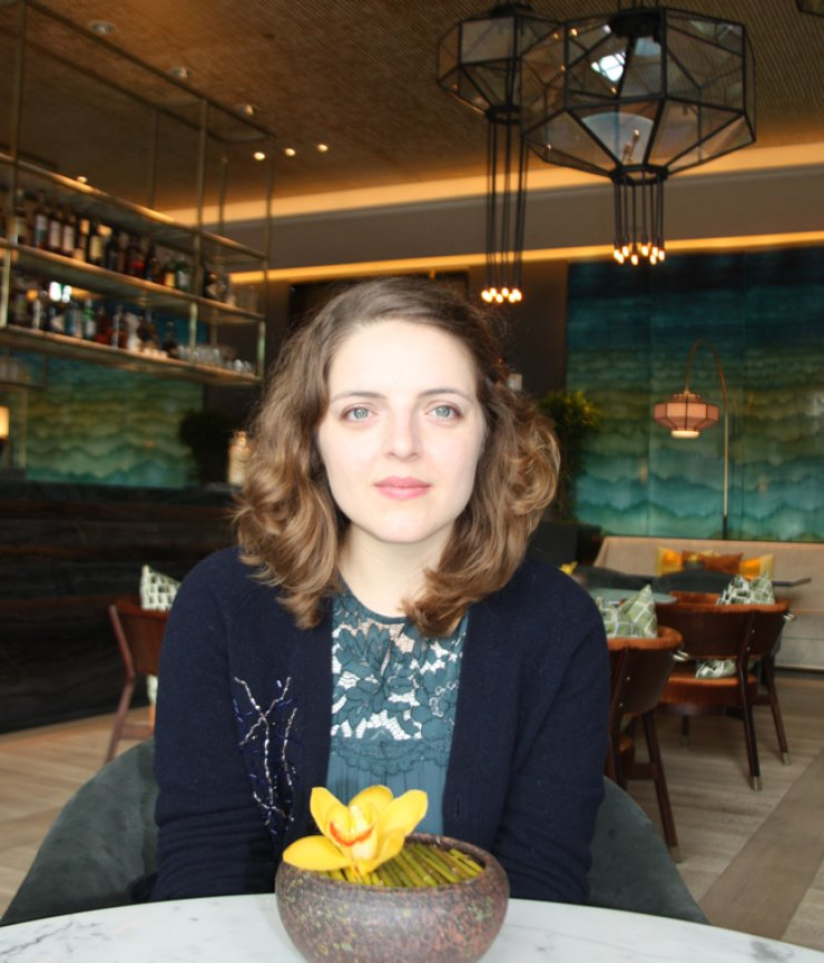 Sophie Bowman from Britain, seen here in a cafe in Seoul during a Jan. 18 interview, has translated numerous Korean poems and short stories into English. / Korea Times file