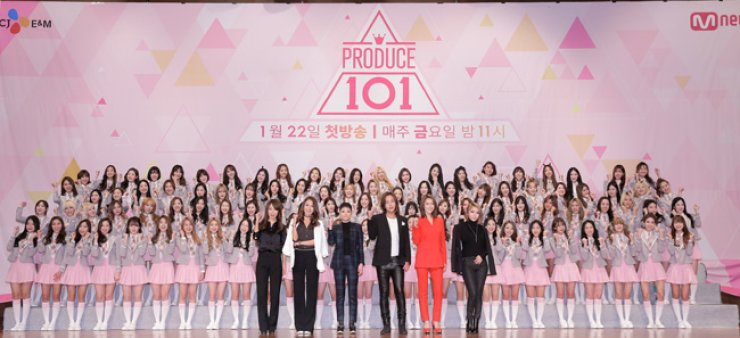 The cast of Mnet's reality girl group survival show 'Produce 101' attend a press conference with 101 girls at 63 Conventional Center, Yeouido, central Seoul, on Jan. 21. From front left are vocal trainer Kim Sung-eun, choreographer Bae Yoon-jung, rapper Cheetah, actor Jang Keun-suk, solo singer Kahi and singer JeA of Brown Eyed Girls. / Courtesy of CJ E&M
