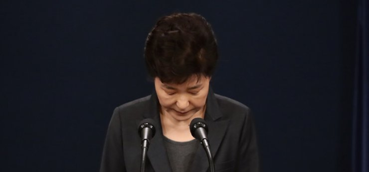 President Park Geun-hye bows in apology for a corruption scandal involving her and her close confidant Choi Soon-sil while delivering a nationally televised address at Cheong Wa Dae, Nov. 4. Offering her second apology in 10 days for the scandal, Park said she will accept investigation by the prosecution and a separate independent counsel investigation, if necessary. / Yonhap