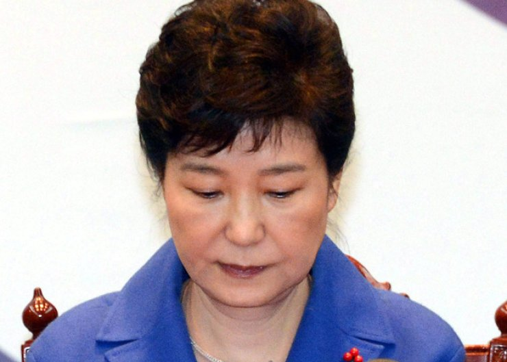 After being impeached by the National Assembly, President Park Geun-hye looks down as she convenes her last Cabinet meeting Friday, right before the vote that suspended her from office. She apologized to the nation again, and asked ministers to minimize any vacuum in government, and to work on the economy. / Korea Times photo by Ko Yeong-kwon
