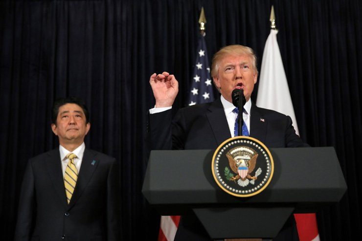 U.S. President Donald Trump delivers remarks on North Korea accompanied by Japanese Prime Minister Shinzo Abe at Mar-a-Lago club in Palm Beach, Fla., Saturday. North Korea fired a ballistic missile early Sunday in what would be its first such test of the year and an implicit challenge to Trump. / Reuters-Yonhap