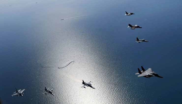 ROK Air Force's fighter jets, including F-15Ks, fly in formation over the West Sea during the Soaring Eagle exercise, Monday. The large-scale combat exercise, aimed at striking North Korea's key nuclear and missile facilities, began last Friday for a one-week run. / Yonhap