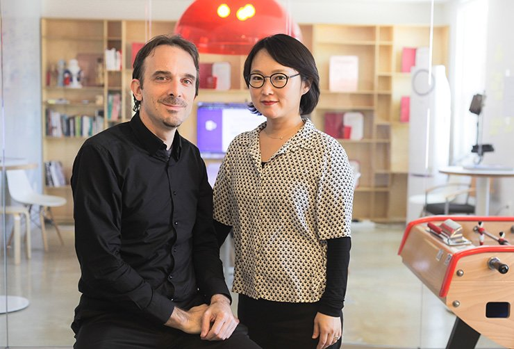 Asiance CEOs and cofounders Olivier Mouroux, left, and Kim Bo-sun pose in their office in Jeong-dong, central Seoul, Wednesday. / Courtesy of Asiance
