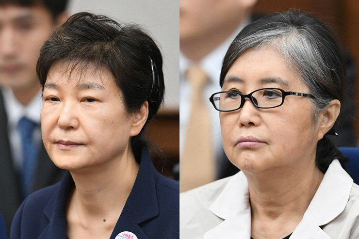 Park Geun-hye, left, and Choi Soon-sil at the Seoul Central District Court, Seoul, May 23. / Joint Press Corps