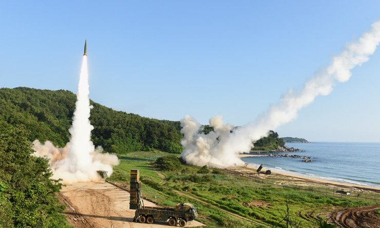 South Korea's Hyunmoo-2A ballistic missile, left, and the U.S. Army's MGM-140 Tactical Missile are fired into the East Sea from an undisclosed location on South Korea's east coast during a joint missile drill, Wednesday, aimed to counter North Korea's intercontinental ballistic missile test conducted Tuesday. / Yonhap