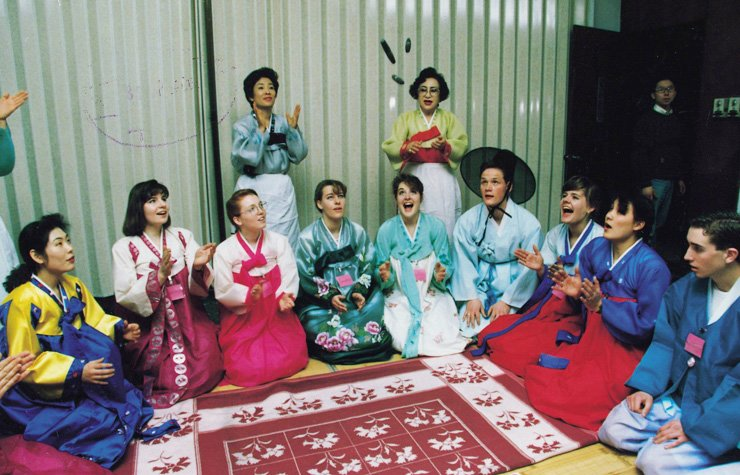 Foreigners and Koreans in traditional clothing play yut, a traditional Korean board game, as they celebrate Chuseok. The holiday is meant to be a joyous reunion of family members and relatives, but it also harbors many risks of a rage-fuelled mental illness called 'hwa byung.'/ Korea Times file