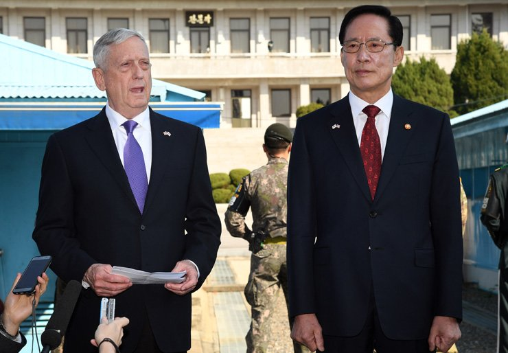 U.S. Secretary of Defense James Mattis, left, speaks to reporters during his visit the Demilitarized Zone with South Korean Defense Minister Song Young-moo, Friday. / Joint press corps