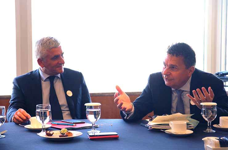 Herve Morin, left, president of Normandy region in France, and Luc Lesenecal, CEO of the French apparel company Saint James, discuss the competitiveness of Normandy and its businesses during a luncheon held in the last week of October in Seoul. / Courtesy of the French-Korean Chamber of Commerce and Industry