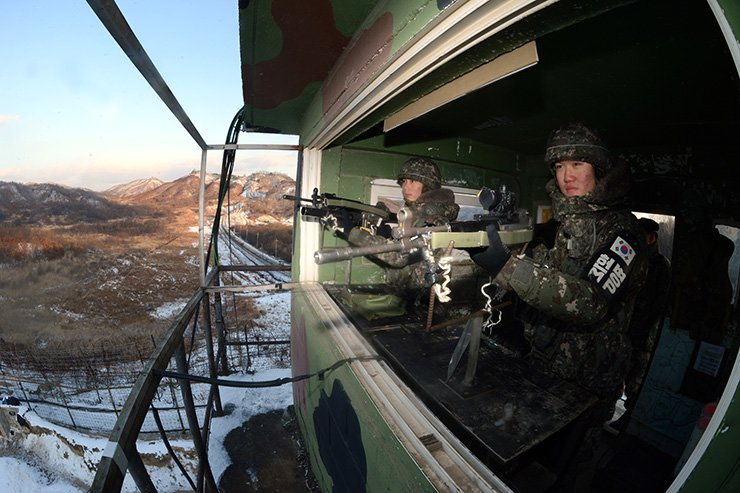 Fear of war with North Korea runs second to concerns about poverty in a recent survey of 1,000 people. In this photo taken on Christmas Day 2014, armed South Korean forces stand guard at a post facing the Demilitarized Zone. / Korea Times file