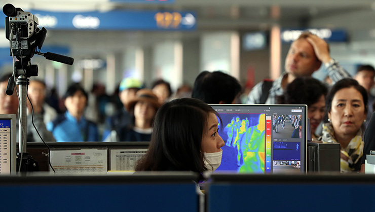 South korea names 59 countries disease prone inbound travelers checkpoint at incheon international airport in this photo taken on july 21 2016 south korea has designated 59 countries disease prone and from jan publicscrutiny Gallery