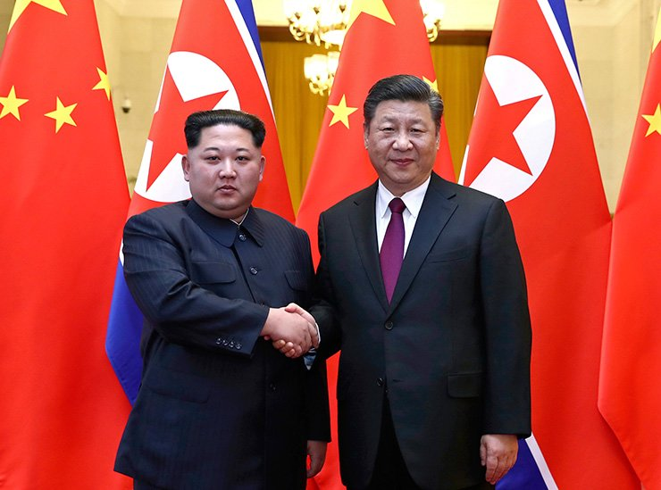 In this photo provided Wednesday, March 28, 2018, by China's Xinhua News Agency,  North Korean leader Kim Jong Un, left, and Chinese President Xi Jinping shake hands in Beijing, China. / Xinhua via AP