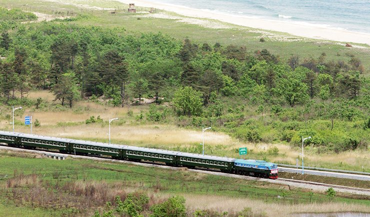 A train bound from South Korea heads to Jejin Station in Goseong County in Gangwon Province in May 2007 after passing the military demarcation line that divides South and North Korea during a test of the connecting section between Gyeongui Line and Donghae Line. Yonhap
