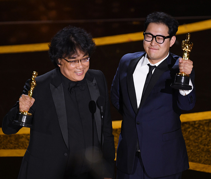 Bong Joon Ho accepts the award for best original screenplay for 'Parasite' at the Oscars on Sunday, Feb. 9, 2020, at the Dolby Theatre in Los Angeles. AP Photo/Chris Pizzello