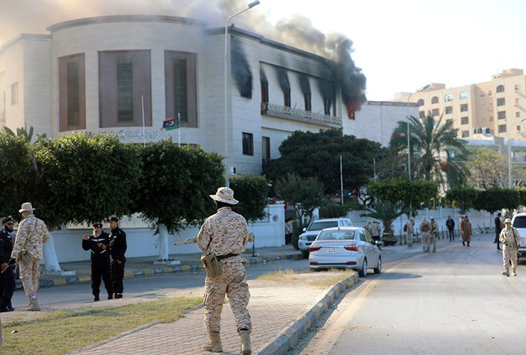 Security forces stand at the site of the headquarters of Libya's foreign ministry after suicide attackers hit in Tripoli, Libya, Dec. 25, 2018. Reuters