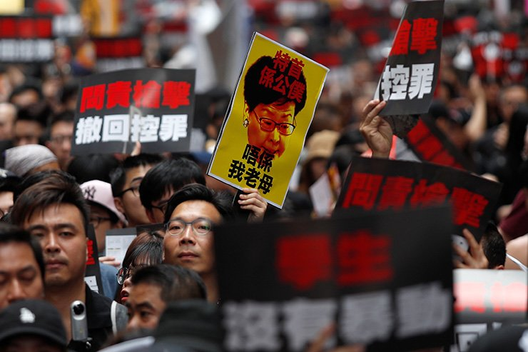 Protesters hold placards as they attend a demonstration demanding Hong Kong's leader Carrie Lam step down and withdraw the extradition bill in Hong Kong, June 16. Reuters