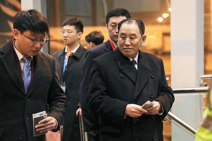 North Korean official Kim Yong-chol, right, prepares to leave the Beijing International Airport in Beijing on Jan. 17. Kim reportedly arrived in Washington for talks with Secretary of State Mike Pompeo. Kyodo News via AP