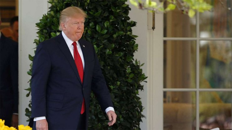 U.S. President Donald Trump, seen here at the White House on Tuesday, says he gave his Chinese counterpart Xi Jinping an ultimatum in their meeting last week.