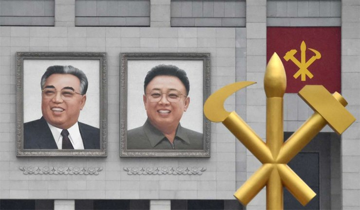 Portraits of North Korea's former leaders Kim Il-sung, left, and Kim Jong-il on the outer wall of the House of Culture in Pyongyang. Some analysts say Kim Jong-un is trying to look more like his grandfather, Kim Il-sung.