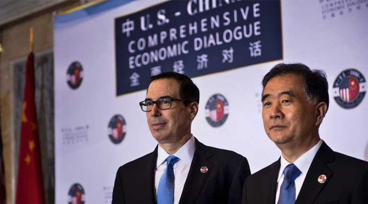 US Secretary of the Treasury Steven Mnuchin and Chinese Vice Premier Wang Yang pose for a photo before an opening session at a US and China comprehensive Economic Dialogue at the US Department of the Treasury on Wednesday.