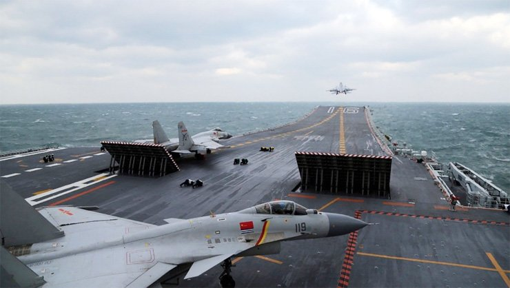 Chinese J-15 fighter jets are launched from the deck of the Liaoning aircraft carrier during earlier military drills in the Yellow Sea on December 23.