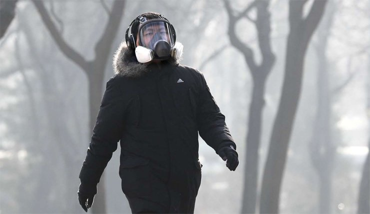 A man wears a mask while exercising in Beijing's Ritan Park in December.