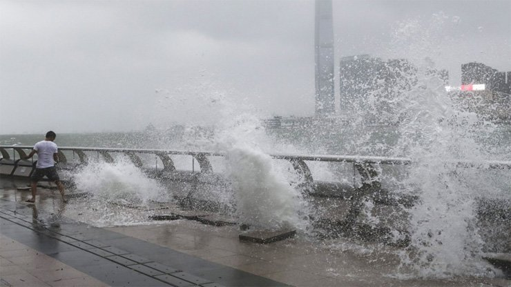 Waves surge at the Wan Chai waterfront as Typhoon Hato hits the city.