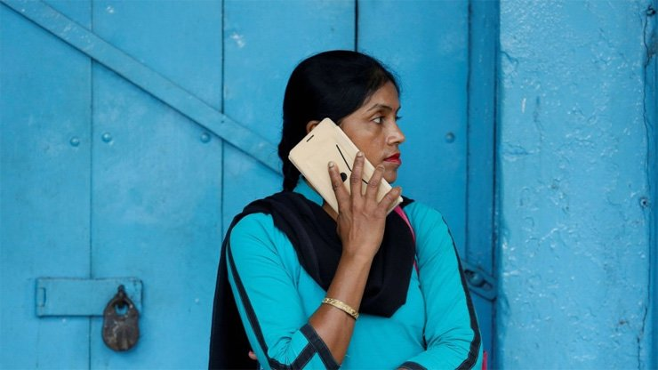 A woman talks on her mobile phone in Kolkata, India. Chinese smartphone makers now dominate the fast-growing market. / Reuters