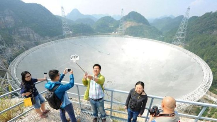 Tourists gather on the Fast telescope observation deck in Guizhou.