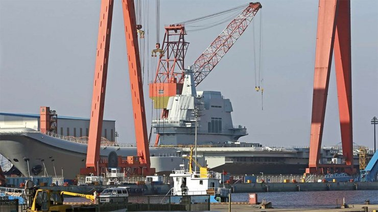 Construction work underway on China's first home-built aircraft carrier in Dalian.