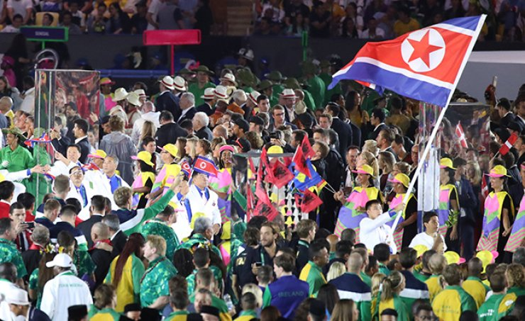 The North Korean delegation, including 31 athletes, march into Maracana Stadium as the 156th country in the 'Parade of Nations' during the opening ceremony of the Rio de Janeiro Olympics, Friday. / Yonhap