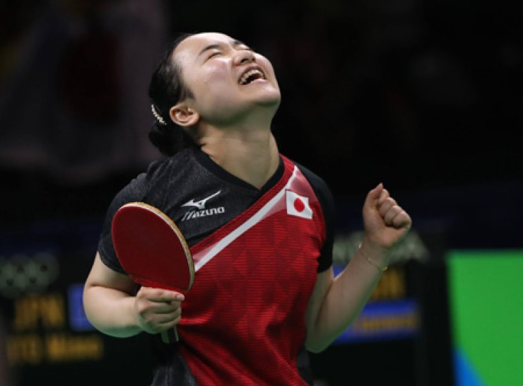Japan's Mima Ito celebrates after her table tennis team won the bronze medal match against Singapore at the Rio Games, Tuesday. / AP-Yonhap